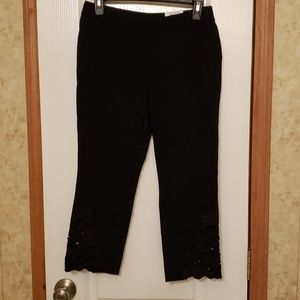 Capris with floral cut outside at the side hem.